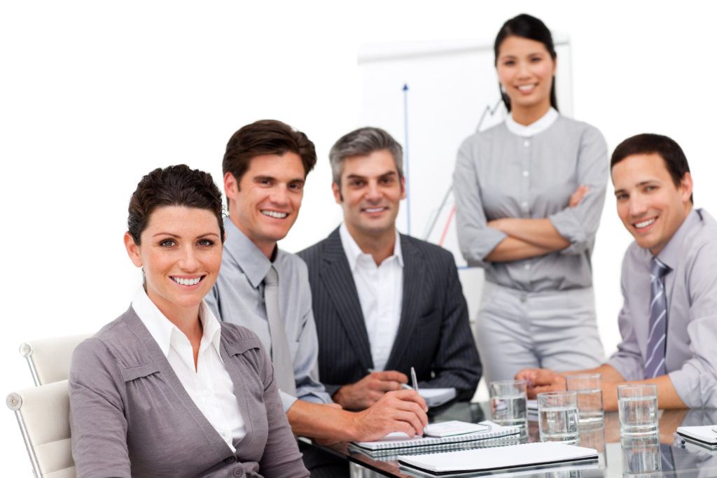Portrait of multi-cultural business team during a presentation in a company